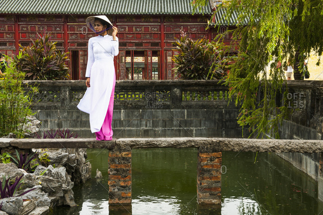 Beautiful woman exploring the imperial palace in Hue / Vietnam