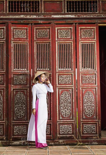 Beautiful woman exploring the imperial palace in Hue / Vietnam