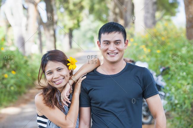 Modern day Vietnamese couple in rural Vietnam