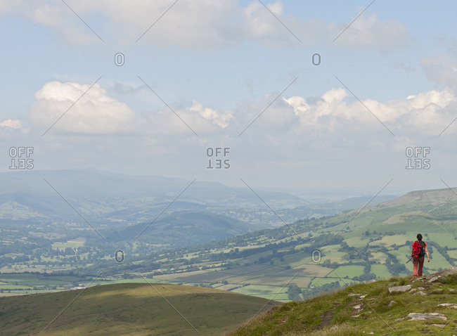 Woman walking through the hills of south Wales