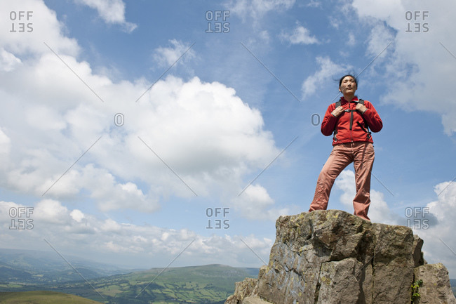 Woman standing on mountain top in south Wales / UK