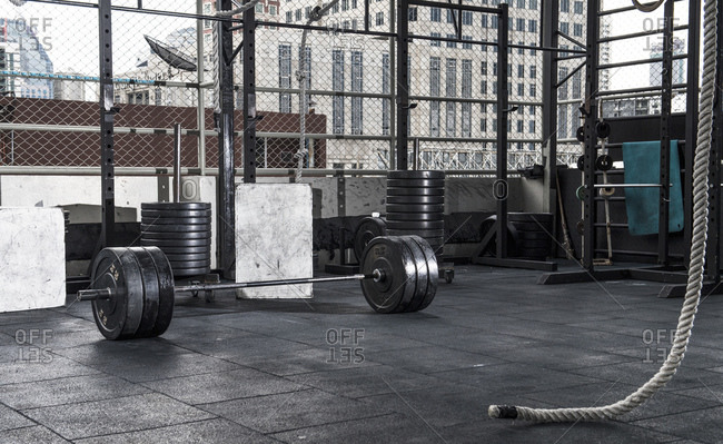 Barbell and weights  at empty rooftop gym in Bangkok