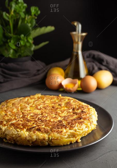 Spanish homemade potato omelet on rustic background