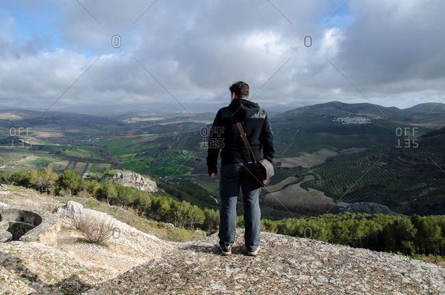 Man observing the horizon from the mountain