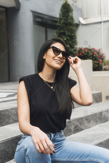 Beautiful Hispanic woman  with jeans t-shirt smiling