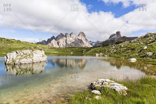 Mount Rautkofel (2826 m) and Schwabenalpenkopf (2687m) reflecting in a little mountain lake, UNESCO World Heritage, Dolomites, Alps, Alto Aldige, Tentino, South Tyrol, Italy