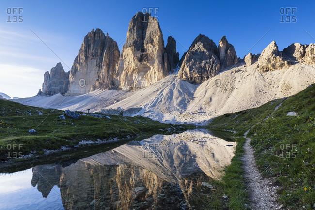 Drei Zinnen (Tre Cime di Lavaredo, 2999m) reflecting in little mountain lake, sunset, UNESCO World Heritage, Dolomites, Alps, Alto Aldige, Tentino, South Tyrol, Italy