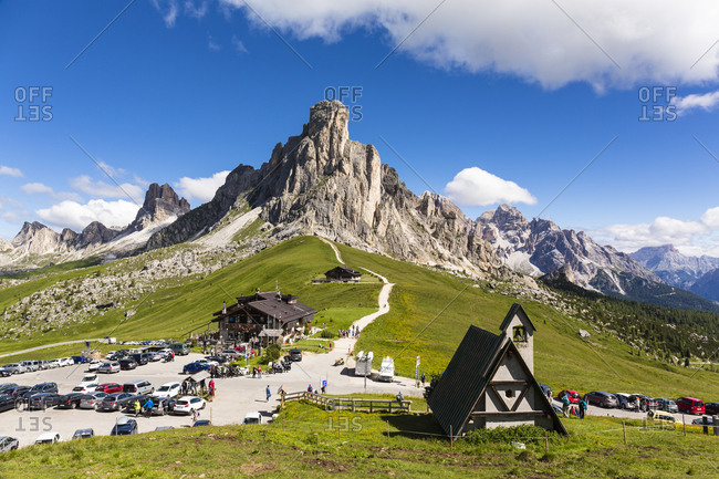 Alpine chalet Passo Giau and little chapel in front of Mount Gusela (2595m) part of Nuvolau mountain (2574m), Giau Pass, Dolomites, Alps, Province of Belluno, Veneto, Italy