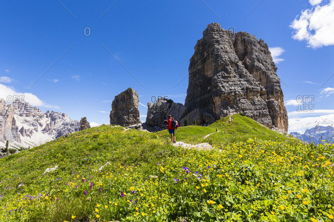 Mountain hiker in front of Cinque Torri (2361m), Dolomites, Alps, Province of Belluno, Veneto, Italy