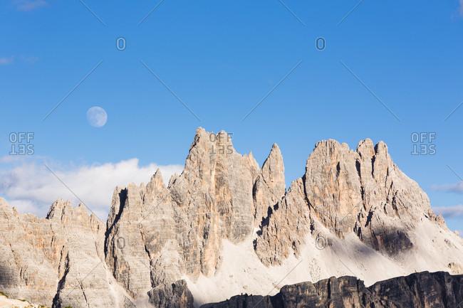 Full moon above Mount Croda da Lago (2700m), Dolomites, Alps, Province of Belluno, Veneto, Italy