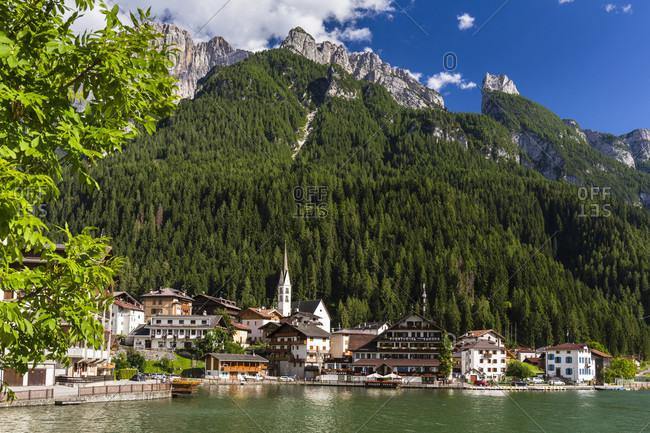 July 18, 2018: Alleghe village in front of Mount Civetta (3220m), Alleghe, Dolomites, Alps, Province of Belluno, Veneto, Italy