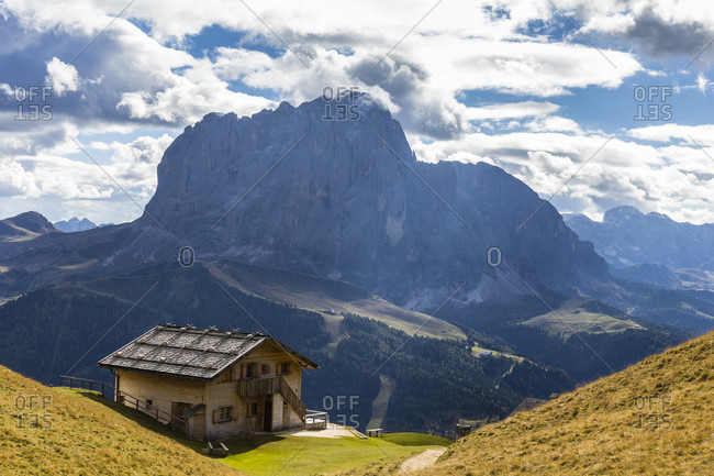October 7, 2018: Rifugio Stevia in front of Langkofel (3181m) and Plattkofel (2969m) at the Seiser Alm, Puez-Geisler Nature Park, UNESCO World Heritage Site, Dolomites, Alps, Alto Adige, Tentino, South Tyrol, Italy