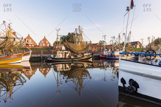 August 27, 2016: Shrimp cutters in the harbor, Greetsiel, Krummhoern, Eastern Friesland, Lower Saxony, Germany