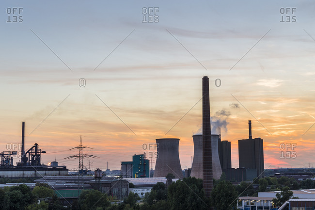 Silhouetted power plant at sunset, Duisburg, Ruhr area, Northrhine Westfalia, Germany, Duisburg, Ruhr area, Northrhine Westfalia, Germany