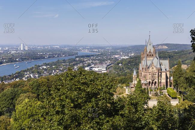 Elevated view on the Drachenburg castle and the River Rhine to Bonn city, Siebengebirge, Koenigswinter, Northrhine Westfalia, Germany