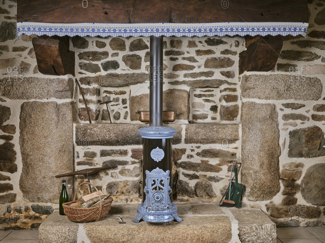 May 2, 2019: Fire pit in a typical Breton country house with a cannon oven in Scrignac, France