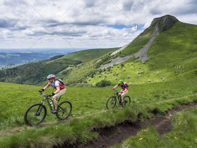 June 26, 2016: Single trail with mountain bikers on the descent from the mountain 'La banne d'ordanche,' France