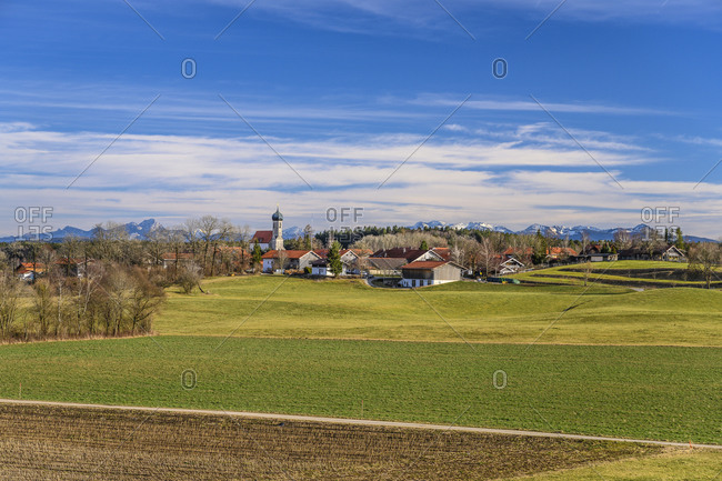 Germany, Bavaria, Upper Bavaria, Tolzer Land, Dietramszell, Lochen district, town view with St. Magdalena church against Prealps