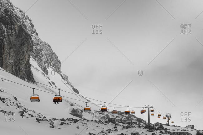 Switzerland, Graubunden, Samnaun, Austria, Tyrol, Ischgl, chairlift from Alp Trida to the Viderjoch on a stormy day