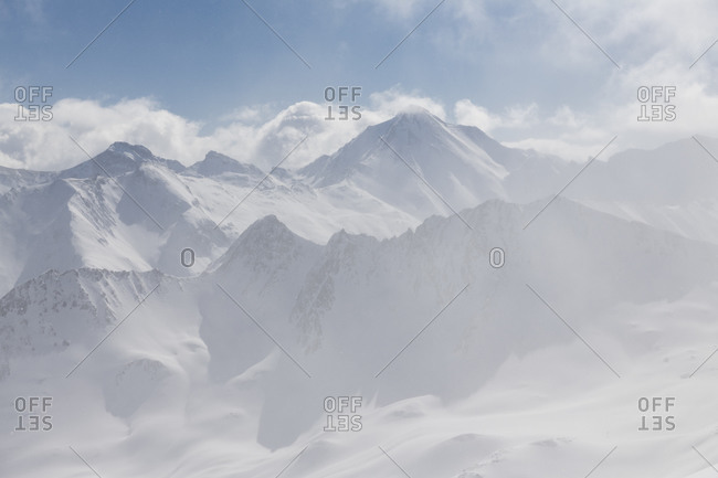 Switzerland, Graubunden, snow flurries in the valley of Samnaun with Piz Malmurainza, Piz Salet, Muttler