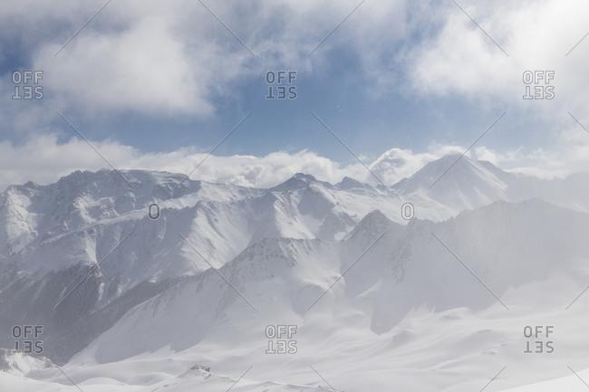 Switzerland, Graubunden, snow flurries in the valley of Samnaun with Piz Mundin, Piz Malmurainza, Piz Salet, Muttler