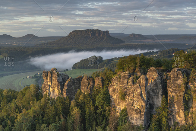 Sunrise in the Elbe Sandstone Mountains with a view of the Bastei and the Lilienstein.