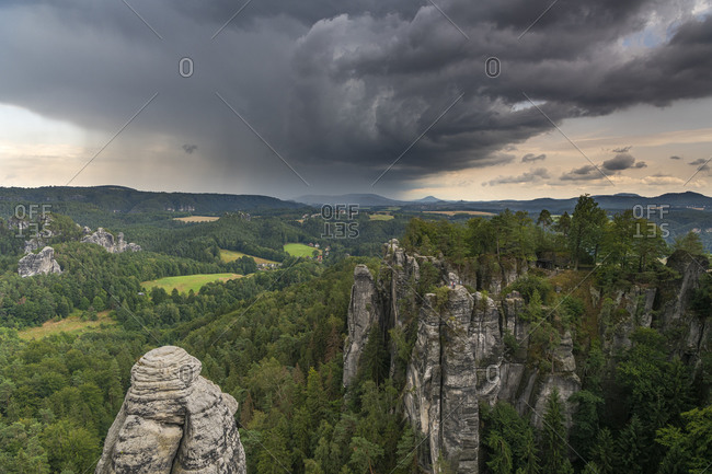Storm clouds over the Bastei bridge in the Elbe Sandstone Mountains.