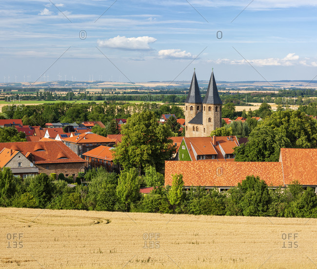 Germany, Saxony-Anhalt, view over wheat field to place and Drubeck monastery