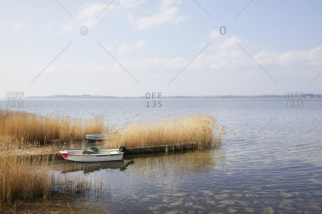 March 30, 2019: Germany, Mecklenburg-West Pomerania, Ruegen, Moenchgut, boat in the reeds