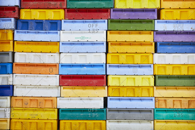 March 30, 2019 - Germany, Mecklenburg-West Pomerania, Ruegen: Colorful stacked fish boxes