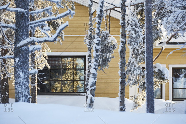 Finland, Lapland, wooden house, yellow, winter