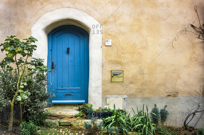 February 17, 2020: Old wooden door in Bages. Located in The Regional Natural Park of Narbonne, France