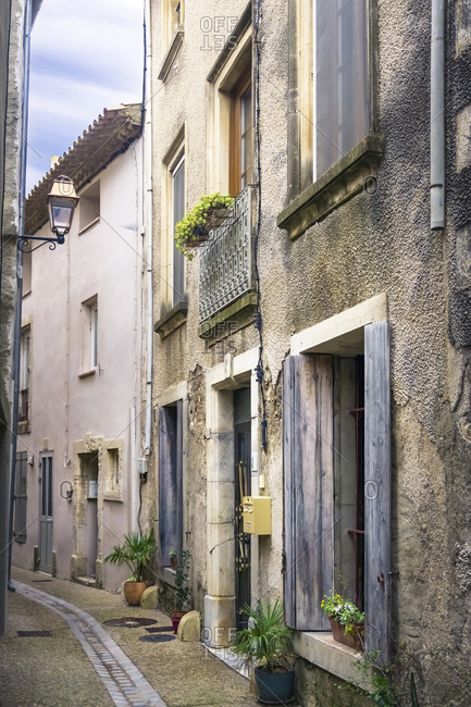 February 17, 2020: Village alley in Peyriac de Mer in winter. The municipality is located in The Regional Natural Park of Narbonne