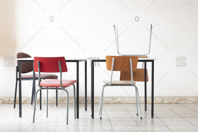 Chairs and tables in bright room