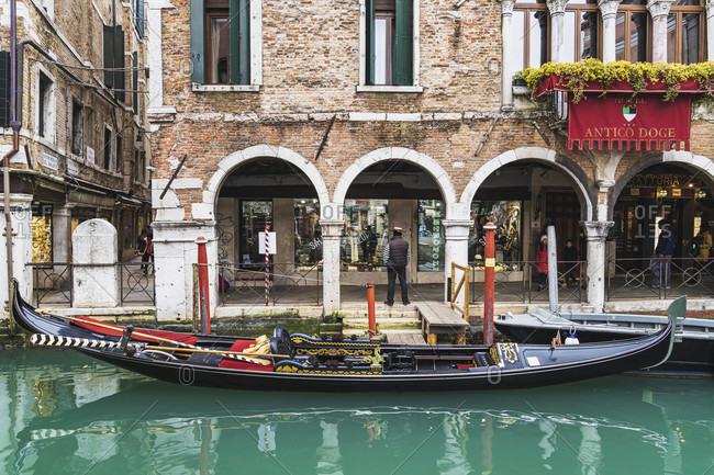 February 1, 2020: Gondolier, Venetian gondola, canal, Venice, historical center, Veneto, Italy, northern Italy, Europe