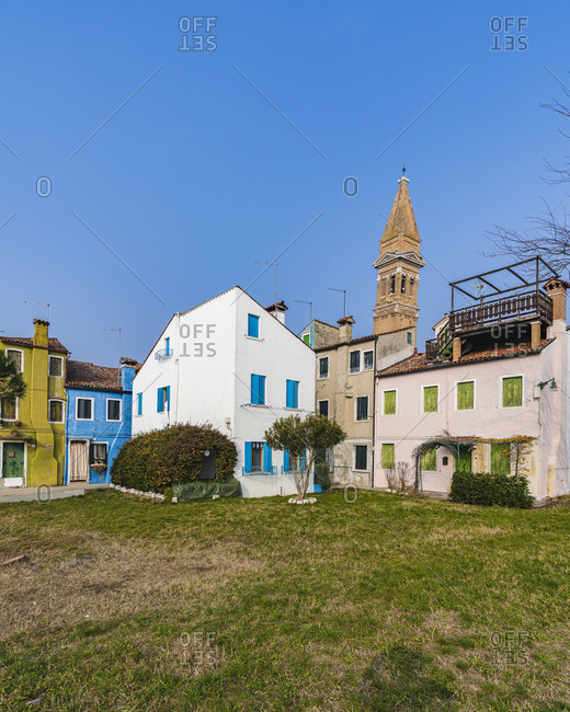 February 3, 2020: Burano, Venice, Island, Veneto, Italy, Northern Italy, colorful fishermen's houses, leaning church tower, Europe