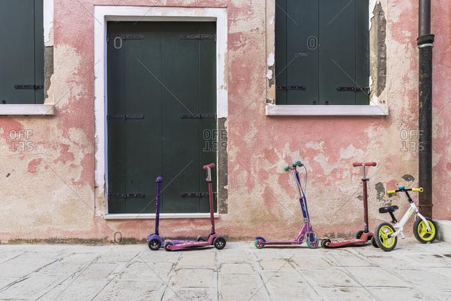 February 3, 2020: Burano, Venice, Island, Veneto, Italy, Northern Italy, children's vehicles, kick scooters, Europe