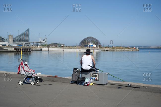 January 3, 2007: Denmark, Aarhus, angler at the harbor