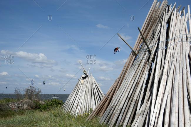January 1, 2007: Denmark, Ringkobing Fjord, wooden pole tents on the beach