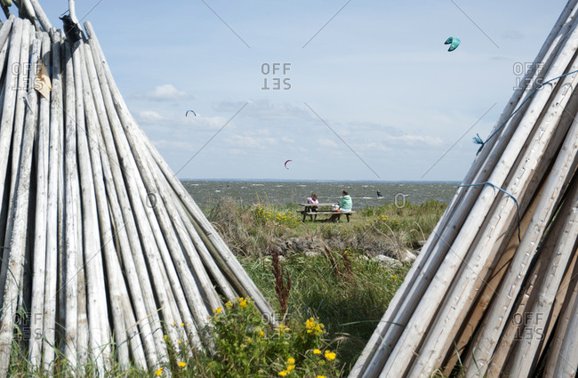Denmark, Ringkobing Fjord, wooden pole tents on the beach