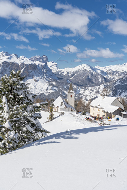 March 4, 2020: Hochabtei / Alta Badia, Bolzano province, South Tyrol, Italy, Europe. The Heilig Kreuz refuge hospice and the pilgrimage church of Heilig Kreuz.
