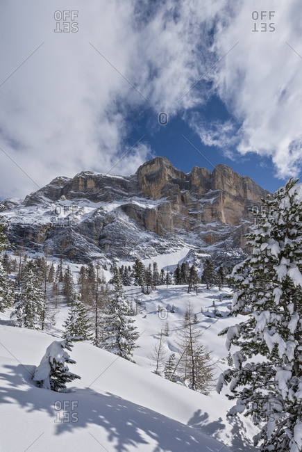 Hochabtei / Alta Badia, Bolzano province, South Tyrol, Italy, Europe. The mighty rock face of the Heiligkreuzkofel