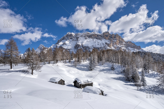 Hochabtei / Alta Badia, Bolzano province, South Tyrol, Italy, Europe. Winter on the Armentara meadows. In the background the peaks of the Neunerspitze, Zehnerspitze and Heiligkreuzkofel