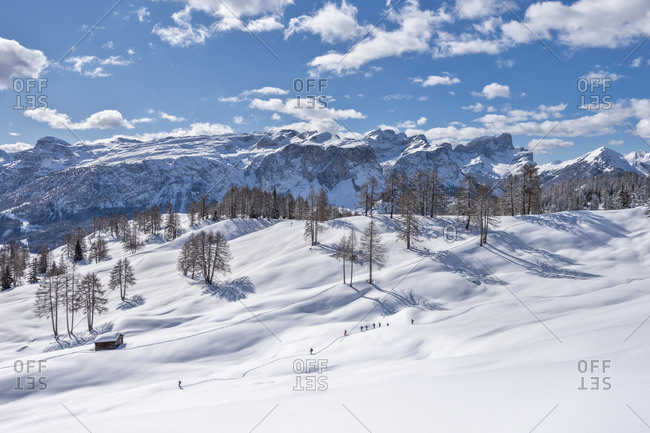 Hochabtei / Alta Badia, Bolzano province, South Tyrol, Italy, Europe. Winter on the Armentara meadows. In the background the Puez Group and the Odle Peaks