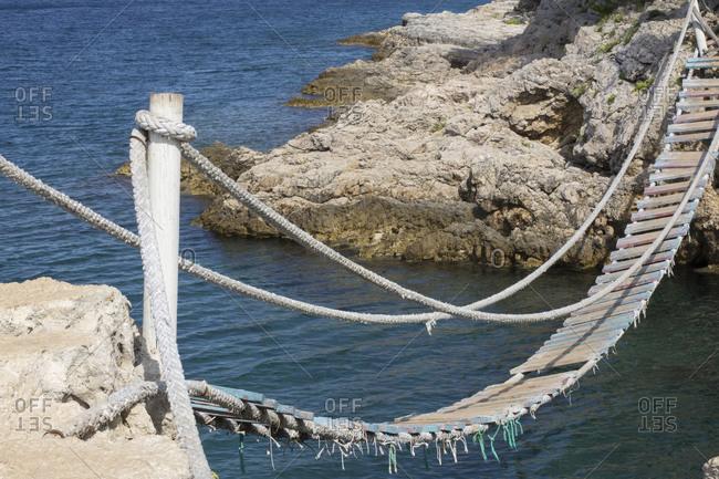 Shaky suspension bridge over water