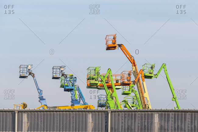 March 26, 2020: Germany, Saxony-Anhalt, Magdeburg, trading port, working platforms and telescopic forklifts.