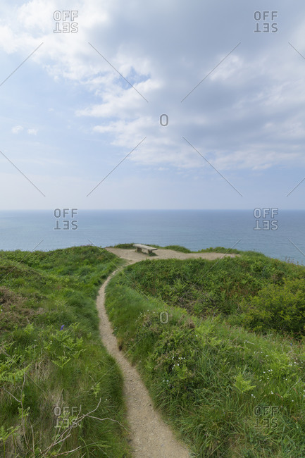Footpath to bench on the coast, Bude, Cornwall, South West England, England, United Kingdom, Europe