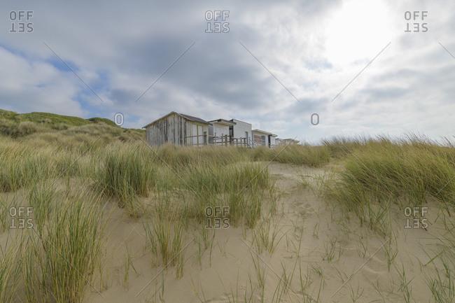 Sand dune with beach houses, Calais, Pas-de-Calais, Hauts-de-France, France