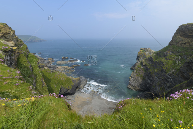 Steep coast in the morning with fog, Godrevy Heritage Coast, Gwithian, Cornwall, England, United Kingdom, Europe