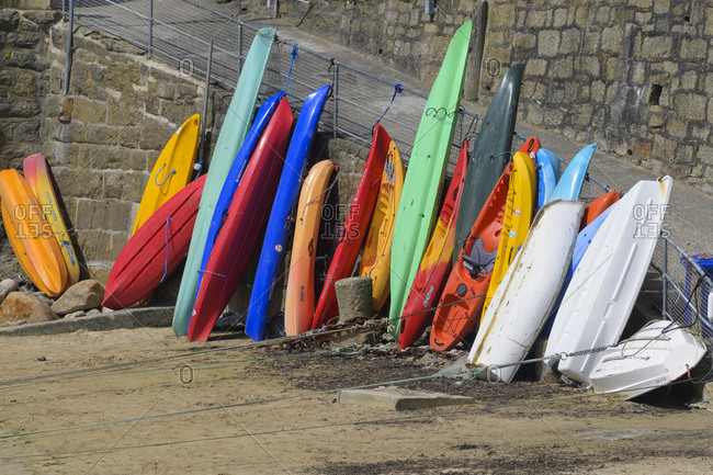 May 28, 2018: Colorful surfboards in the harbor, Mousehole, Penzance, Cornwall, South West England, England, United Kingdom, Europe